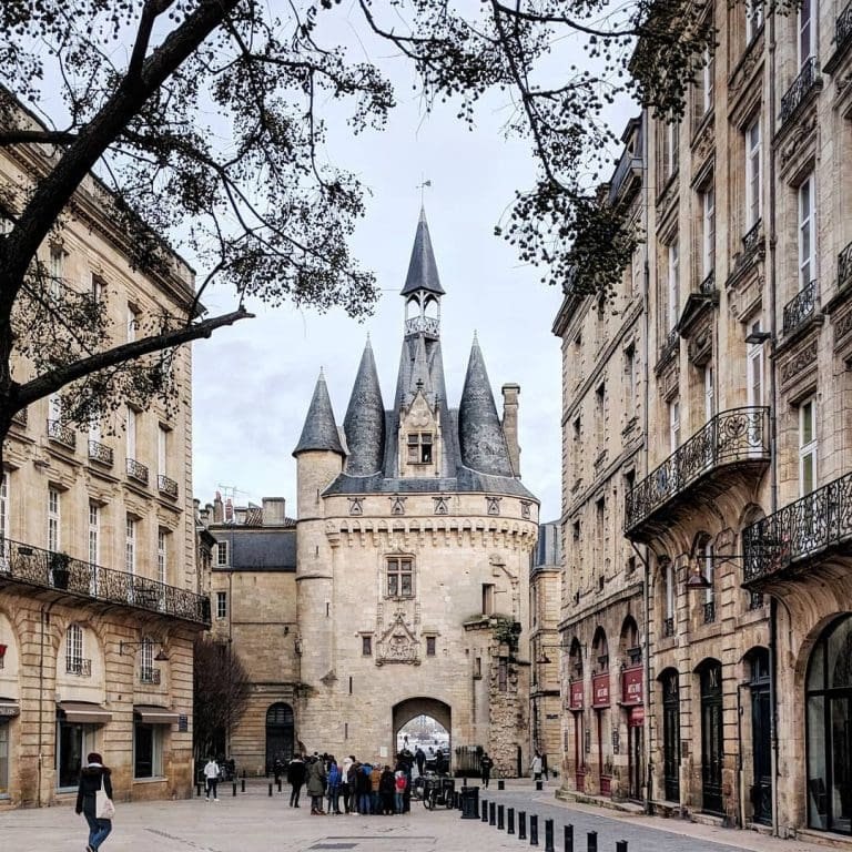 porte cailhau in bordeaux, france - a gorgeous clock tower that looks like a castle