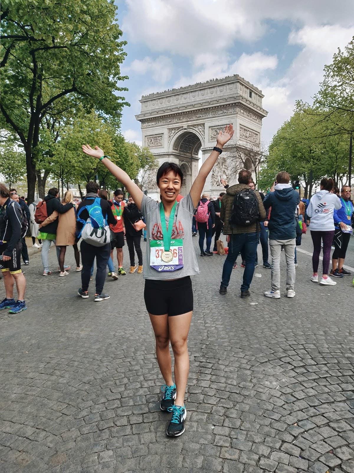 Me at the Paris Marathon in front of the Arc de Triomphe