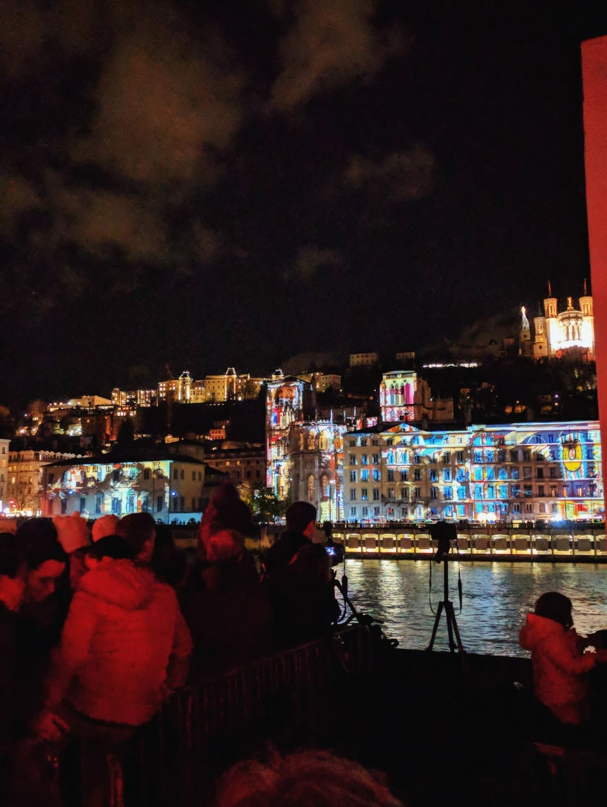 lyon festival of lights crowd by the river