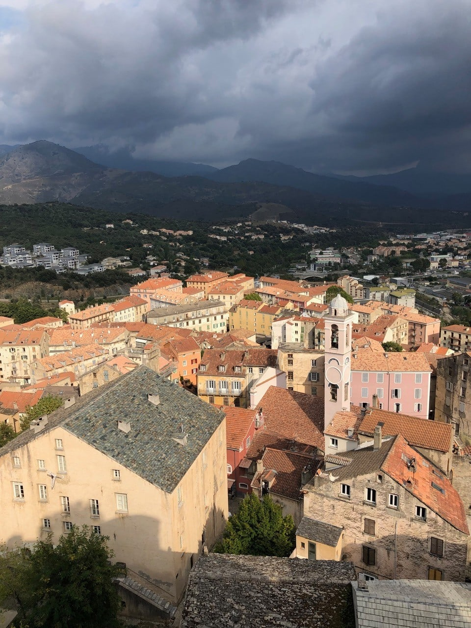 rooftops and mountains in corsica, france