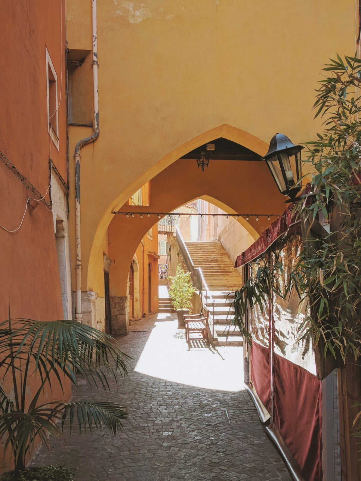 Pink and orange archway in Villefranche-sur-Mer, France