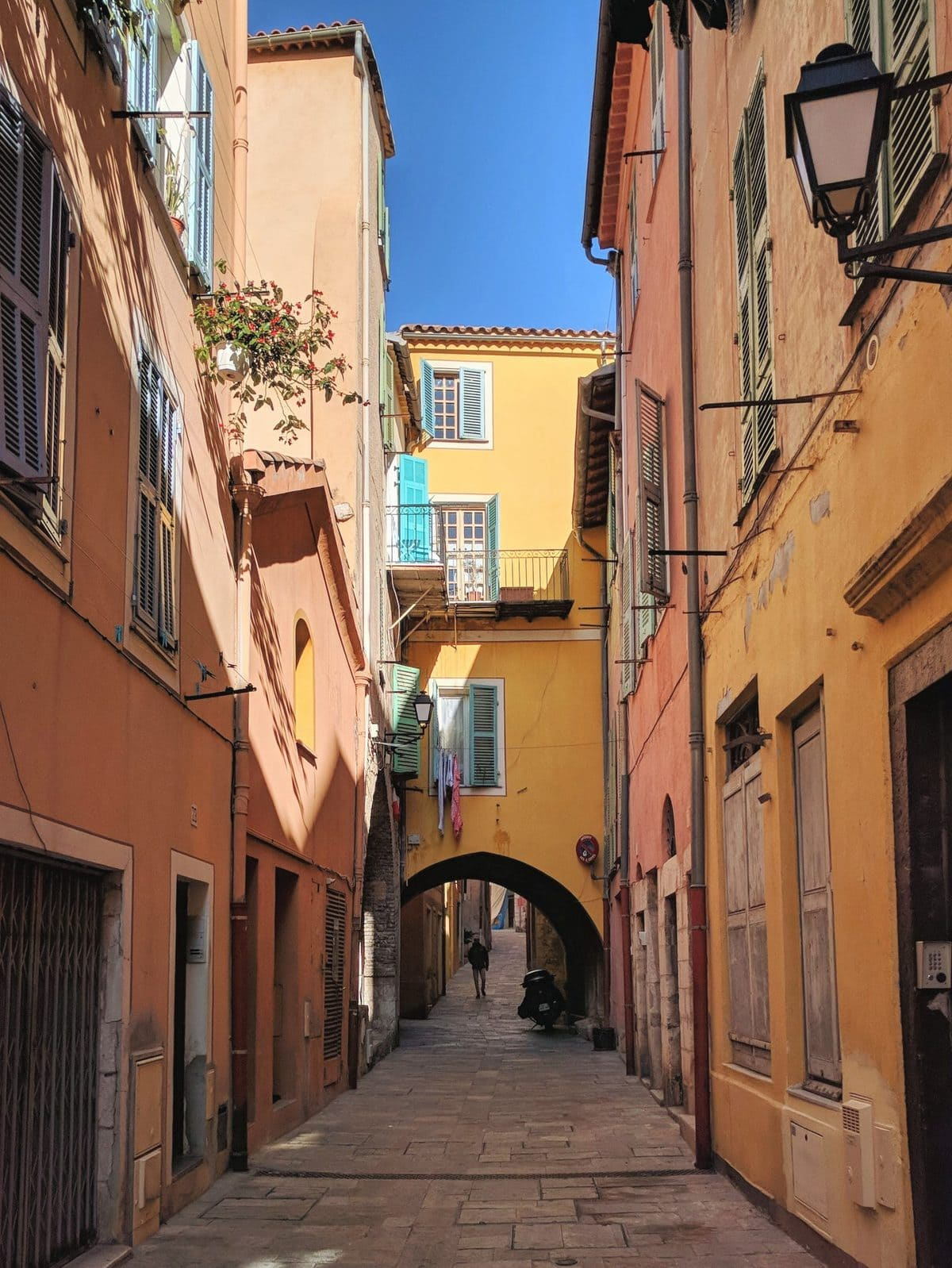 Colorful buildings in a quiet street in Villefranche-sur-Mer, France