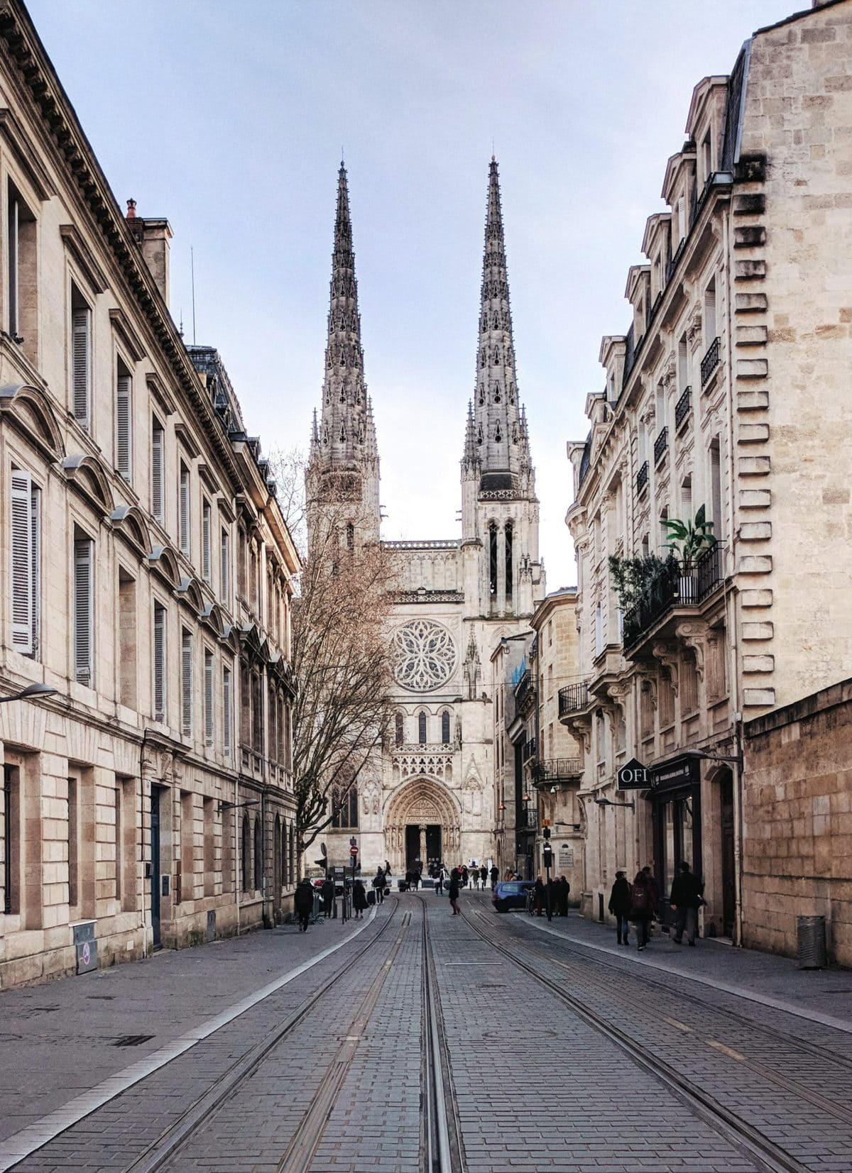 View of Bordeaux Cathedral from the street with buildings framing the cathedral perfectly
