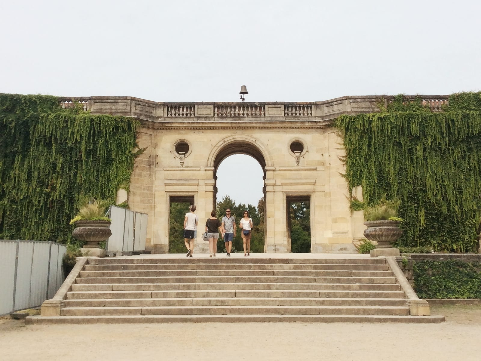 ivy-covered archways in jardin public in Bordeaux, France