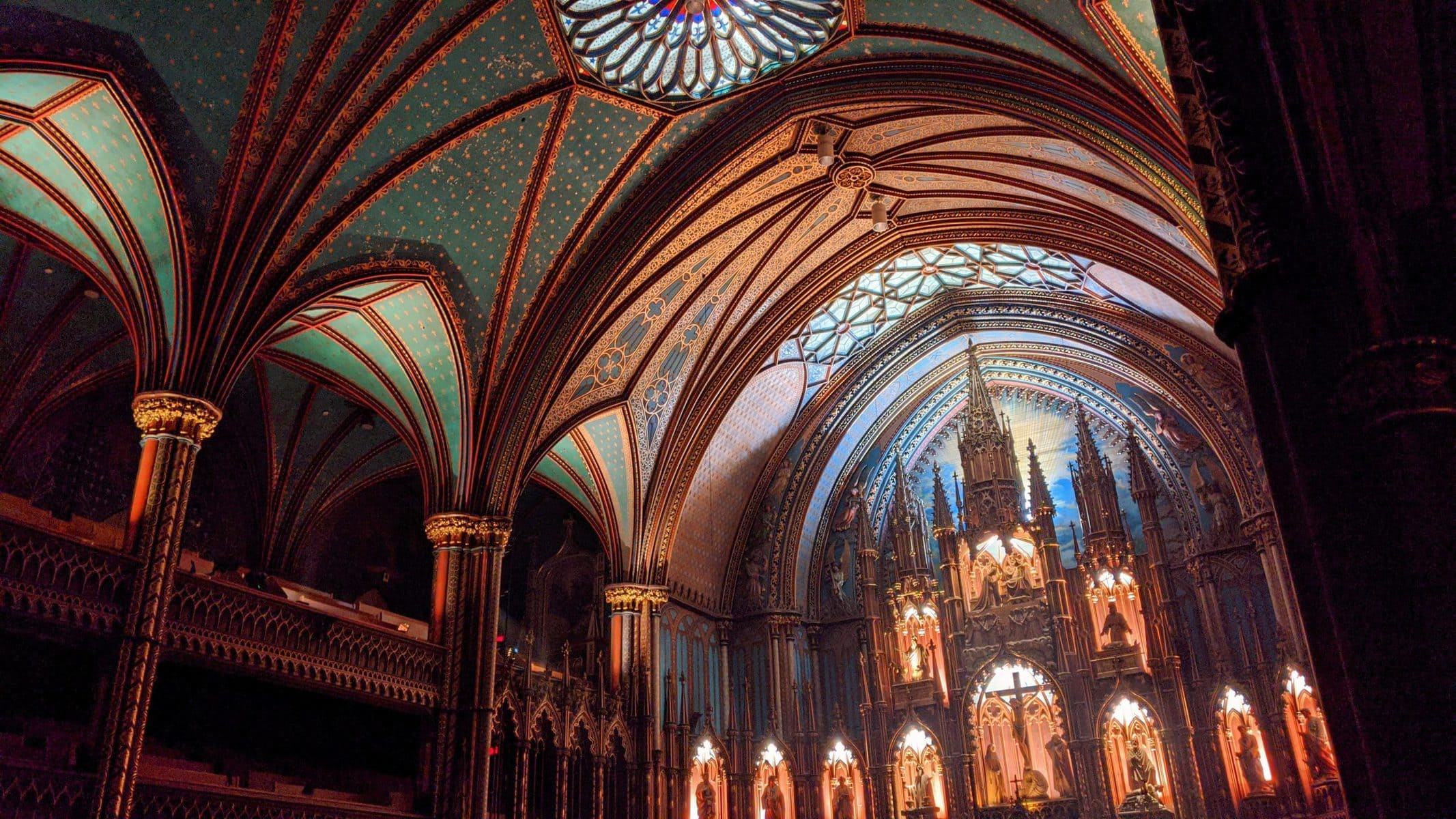 The ceiling of the Notre-Dame Basilica in Montreal at night during the Aura light show