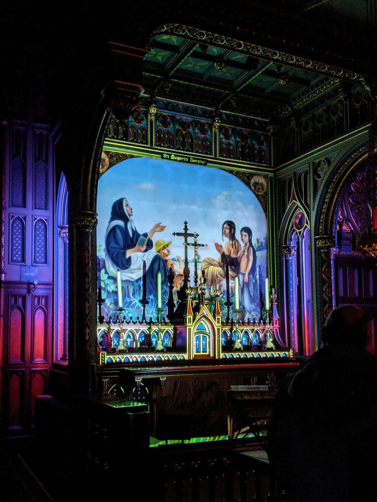 Illuminated religious painting at Aura Montreal at the Notre-Dame Basilica