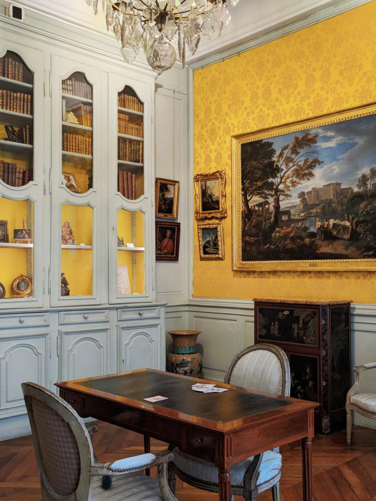 A mint and yellow colored room at the Musee Magnin in Dijon, France