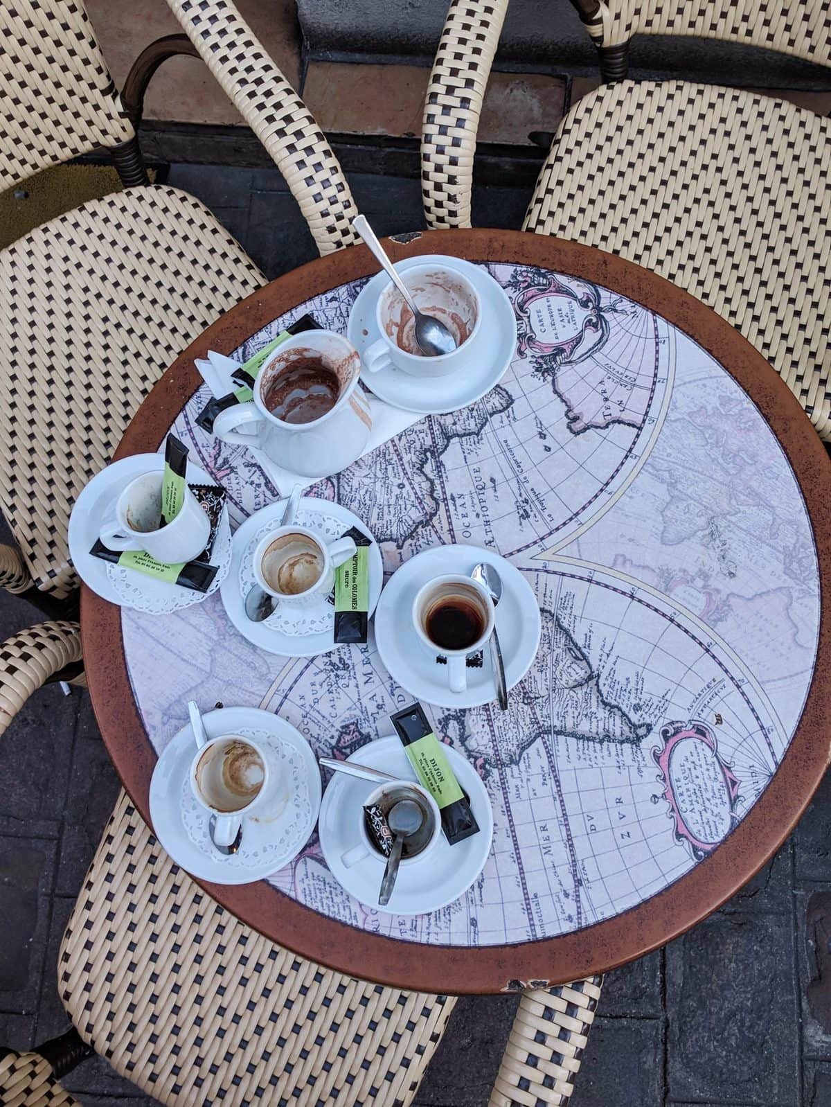 Flatlay of espressos in a French cafe