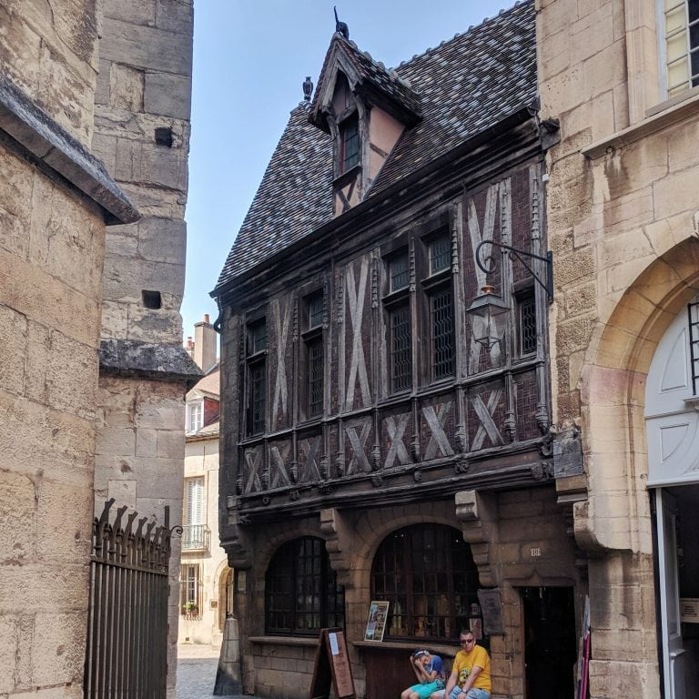 Maison Milliere in Dijon, France - a dark brown half-timbered house that's a traditional French restaurant