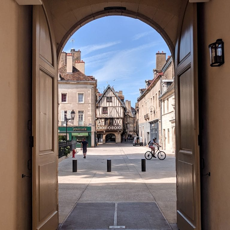 View of Dijon's half-timbered houses through a door at the Museum of Fine Arts