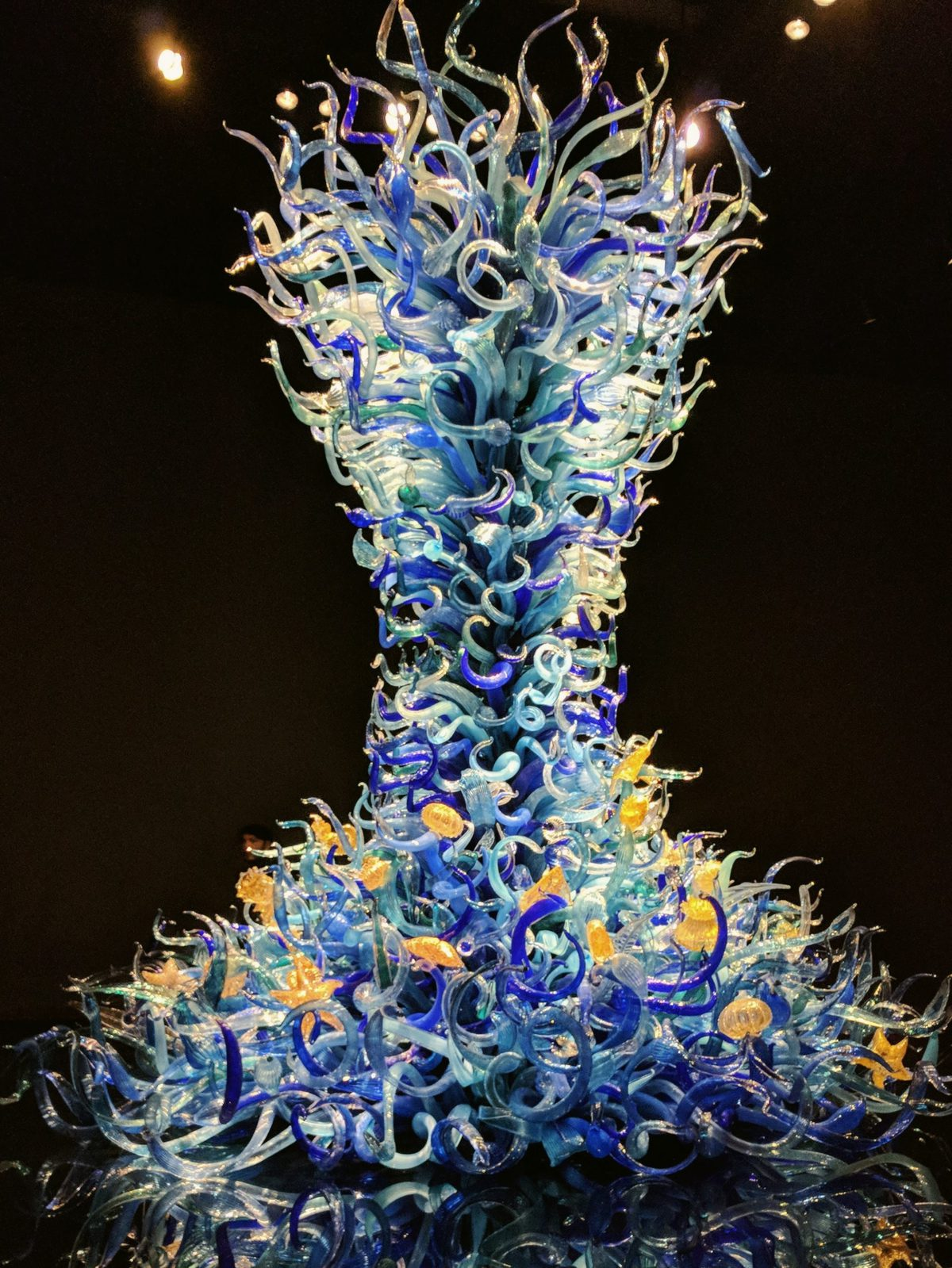 A massive blown glass installation Chihuly Garden and Glass that stretches from the floor to ceiling