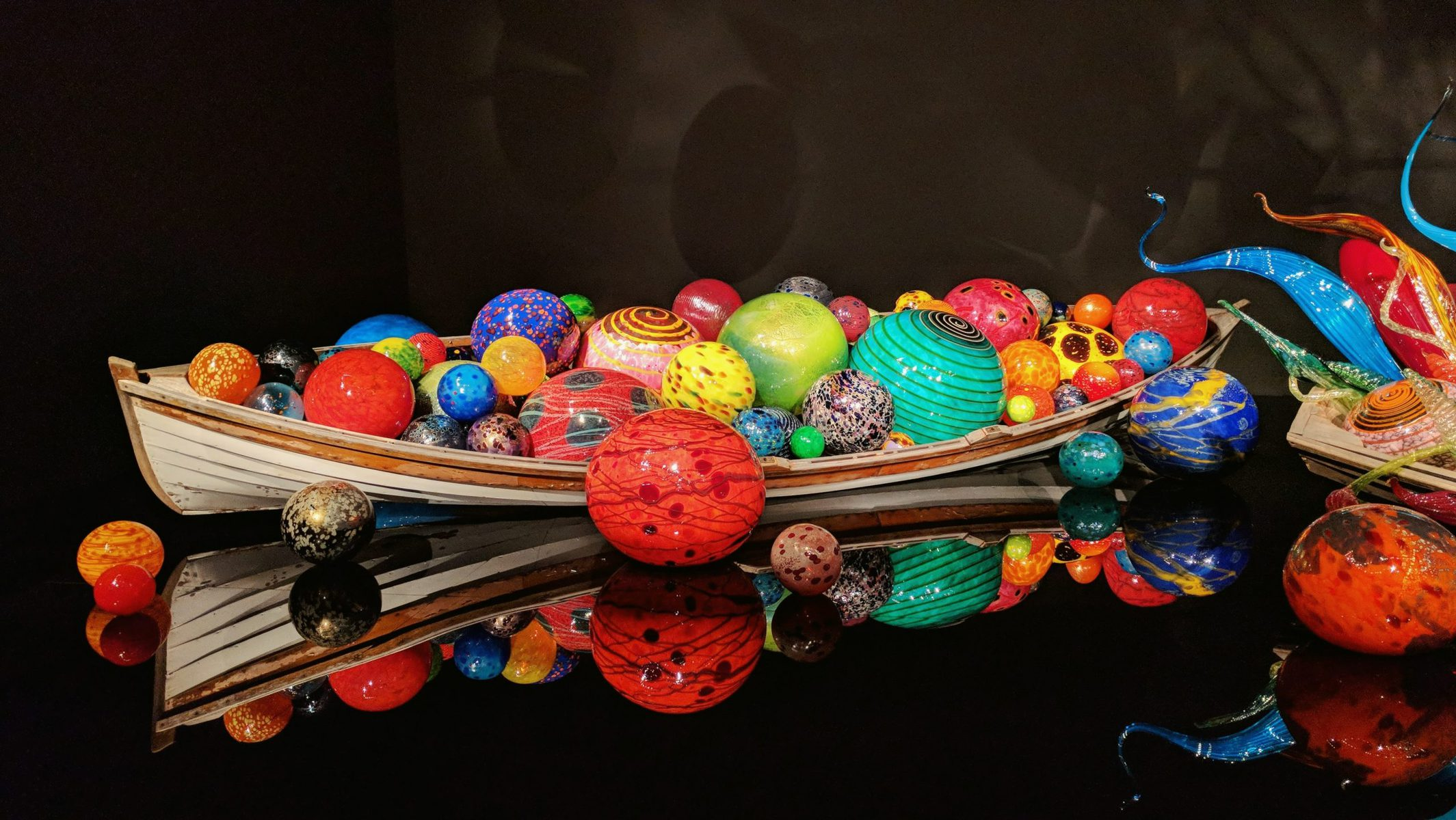 A boat filled with colorful blown glass balls at Chihuly Garden and Glass