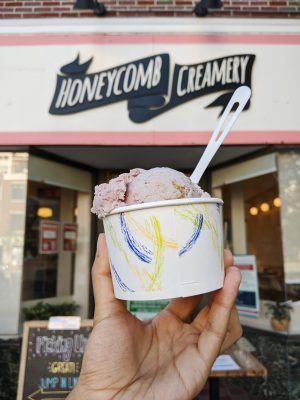 Honeycomb Creamery storefront with vegan ice cream in foreground