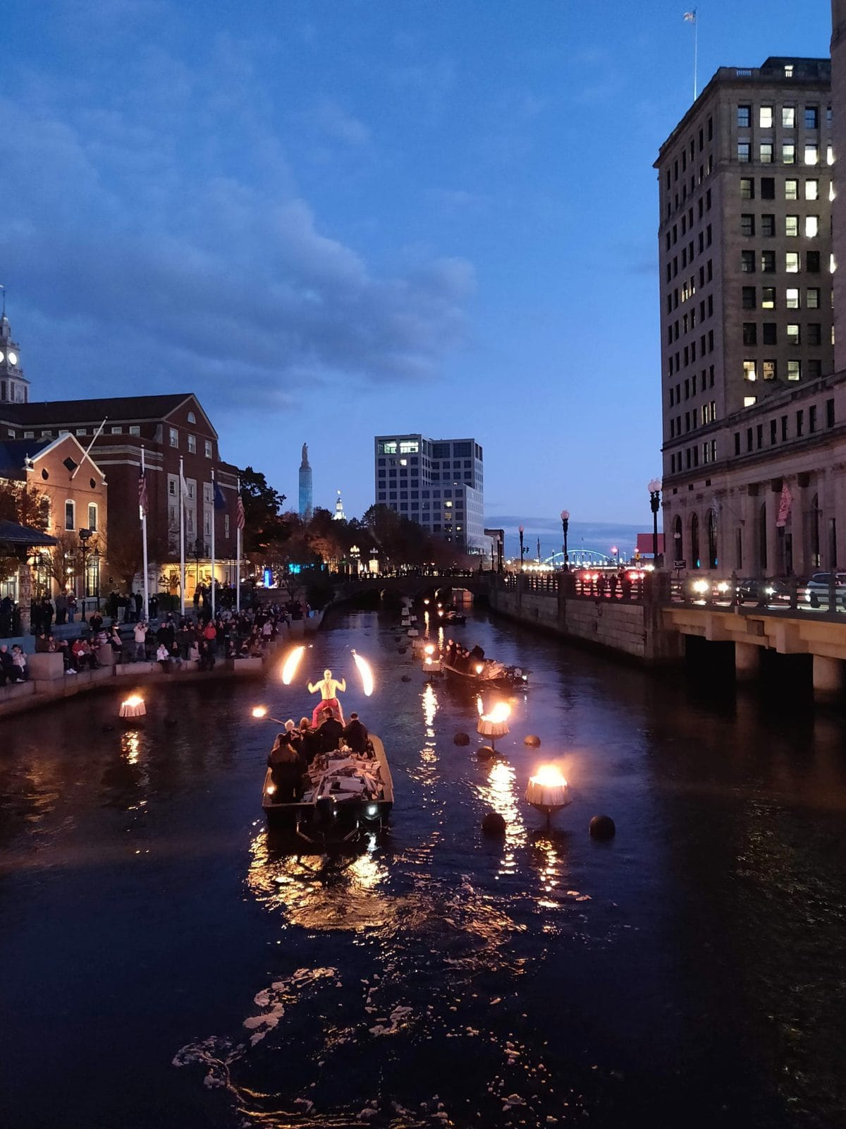 Waterfire in Providence, RI with a fire performer on a boat