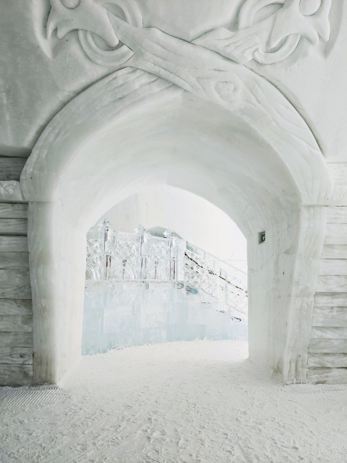 The ice stairway spotted through a snow archway