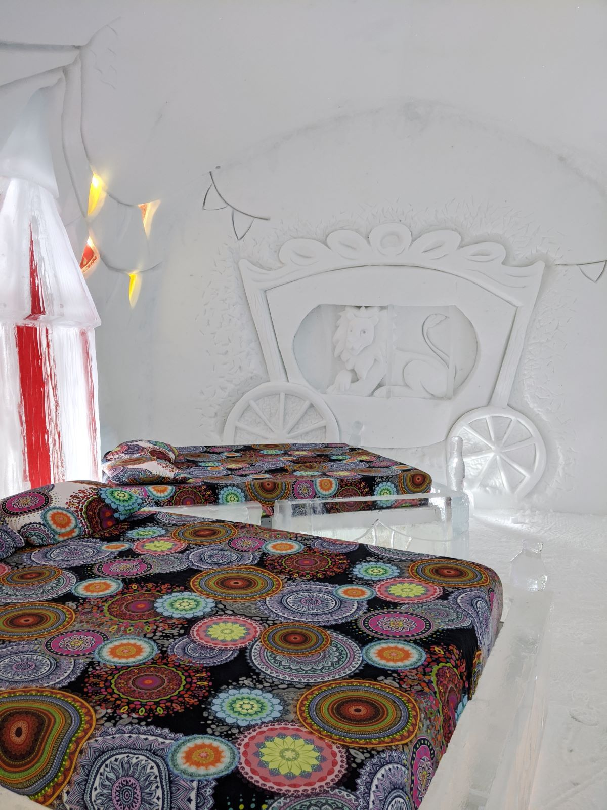 Circus room with circus tents carved into ice, plus a circus carriage containing a lion carved into the snow walls