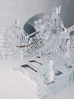 Intricate dragons carved into the ice staircase