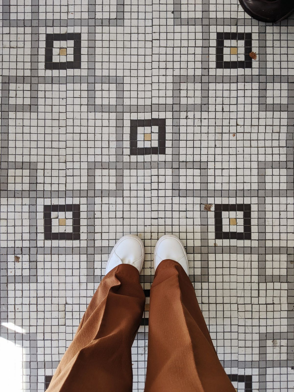 wearing the Scooter One shoes with pleated pants on a tiled floor