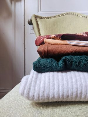 pile of clothes on a green chair
