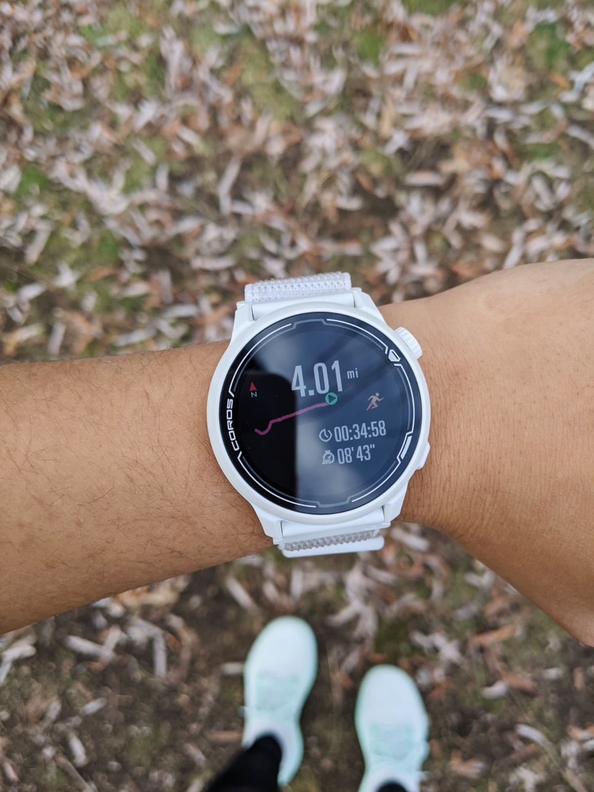 the watch face of the white COROS PACE 2 with a nylon band after a run