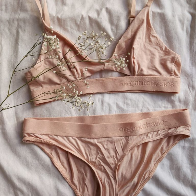 Organic Basics Tencel Starter Pack with a nude/rose color triangle bra and the same color briefs