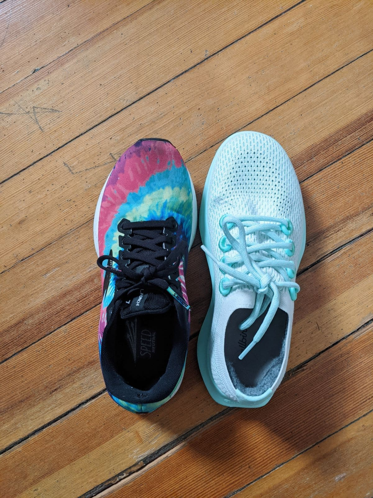 My tie dye Brooks Launch 7 in size 7.5 next to the Cyclone Allbirds Tree Dashers in size 8