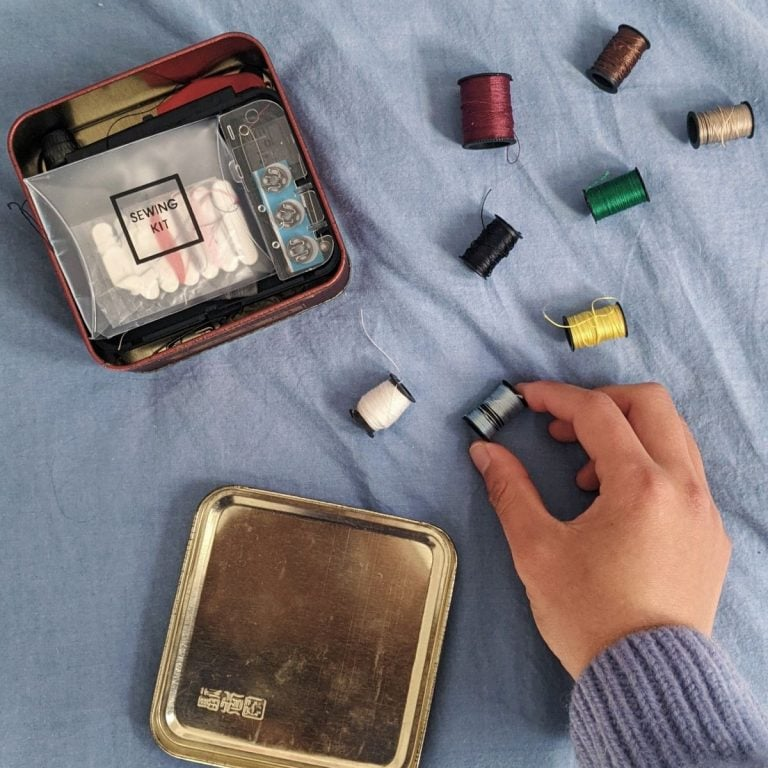 sewing kit on a blue sheet