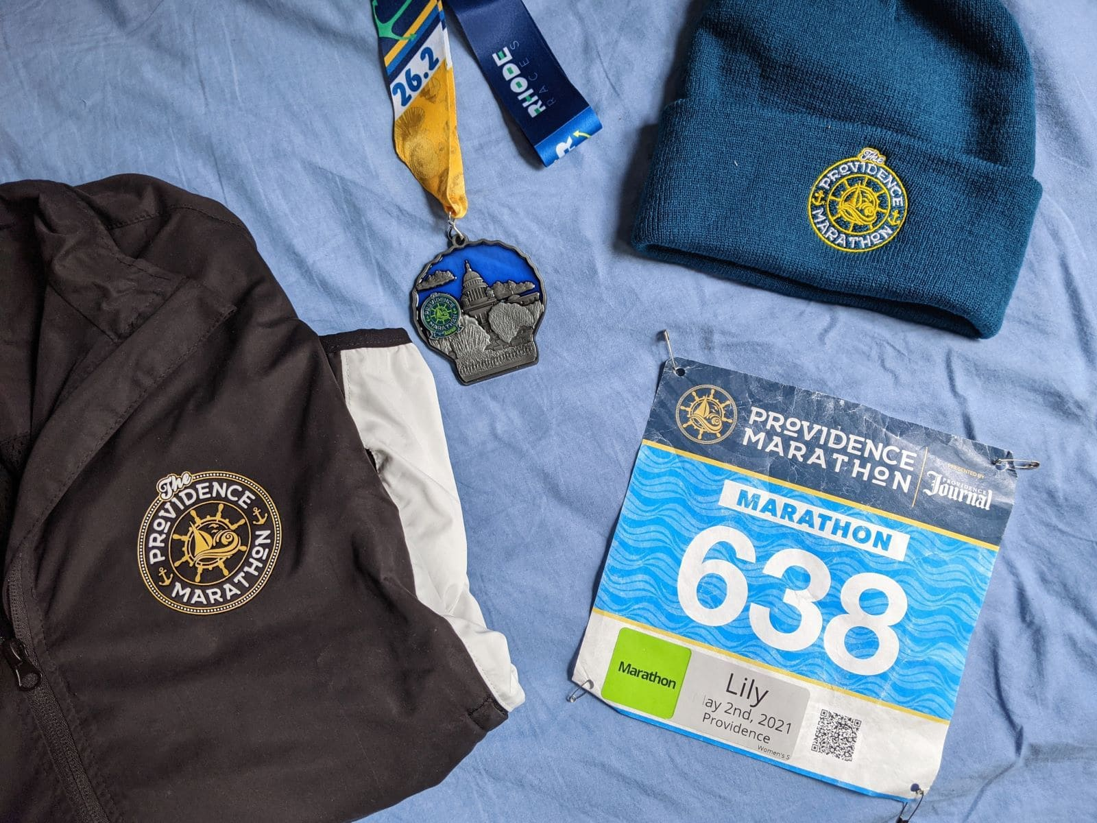 Providence Marathon medal, jacket, and beanie