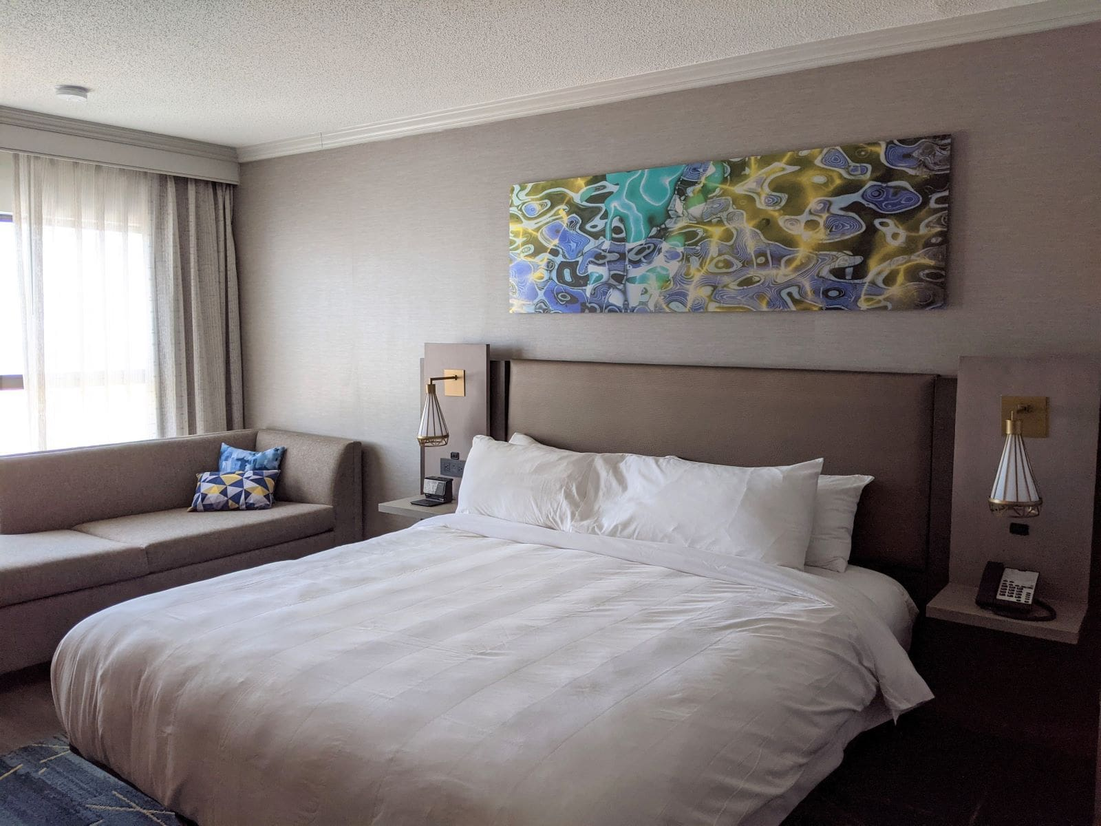 larger King room in the Providence Marriott Downtown Hotel with a King bed and couch bed