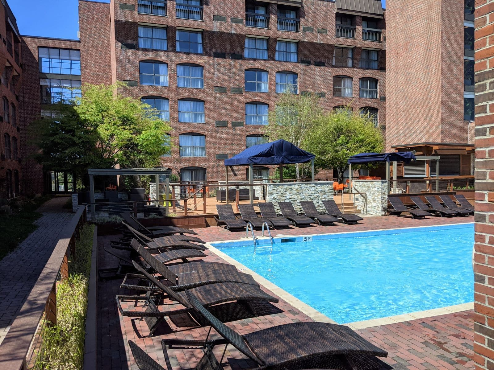 outdoor pool of the Providence Marriott Downtown with lounging chairs