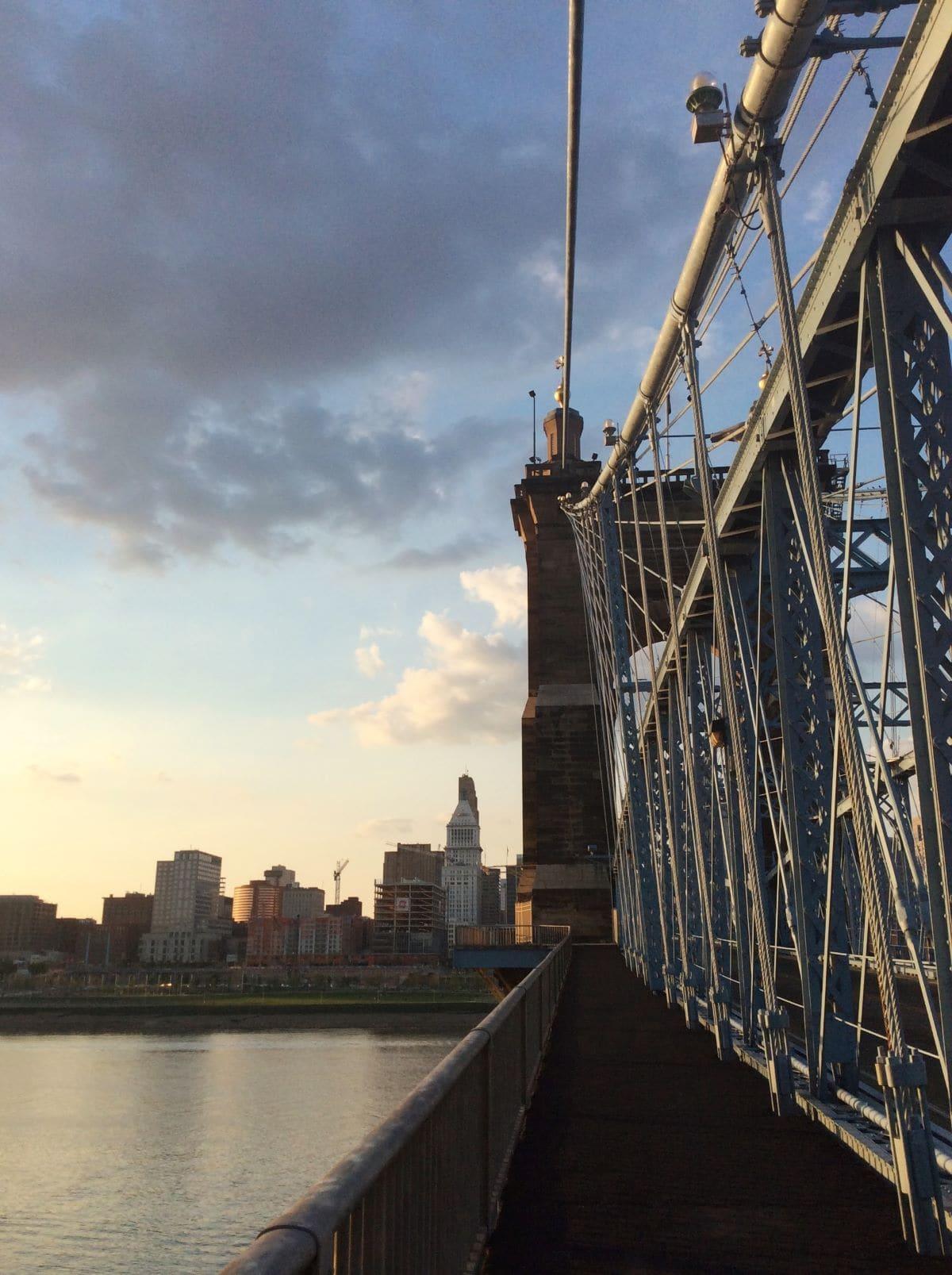 Suspension bridge overlooking the Ohio River into Cincinnati at sunset