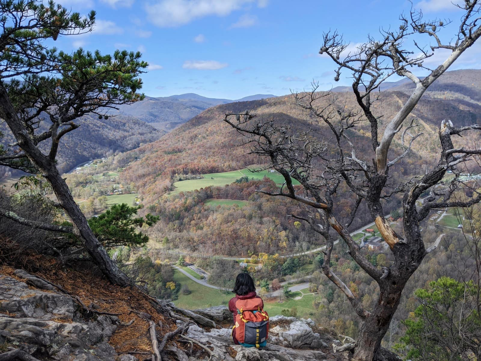 Me with my back to the camera overlooking the panoramic view at the peak of Seneca Rocks