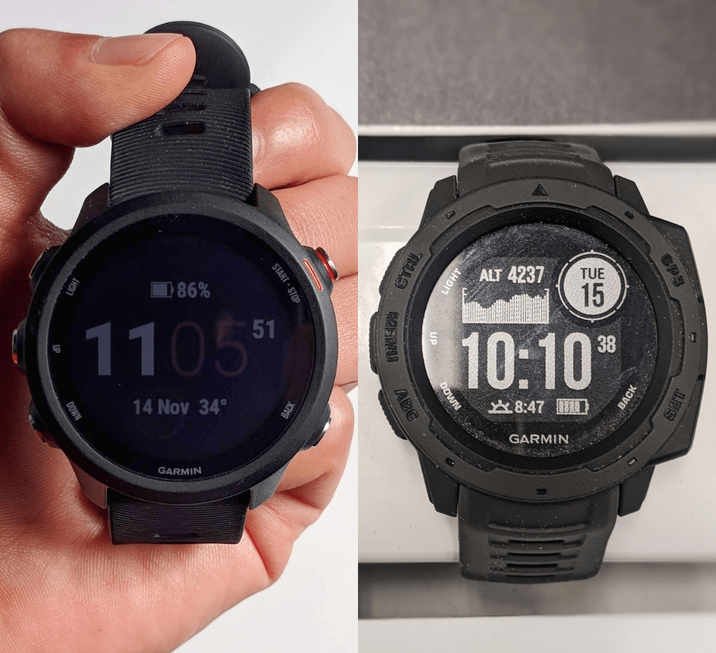 Garmin Forerunner 245 in black on the left and Garmin Instinct in black on the right