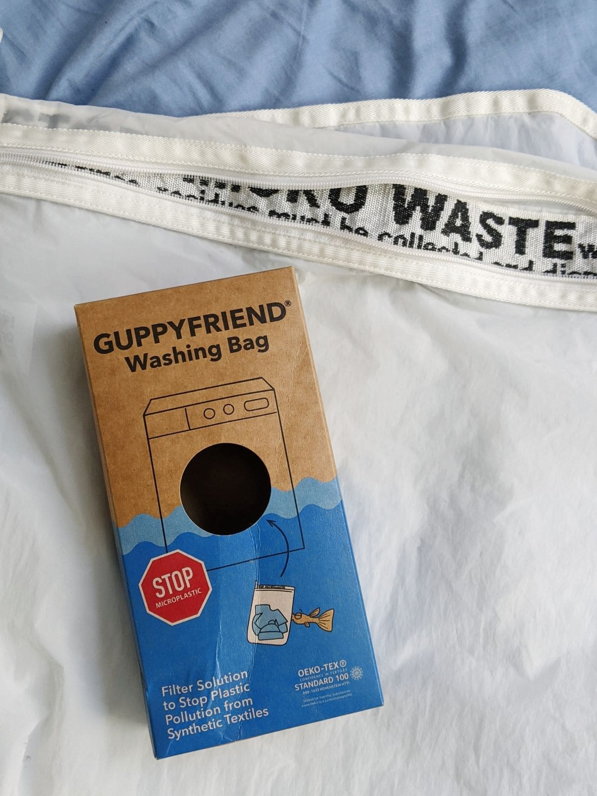 Guppyfriend washing bag with the box for the bag on top