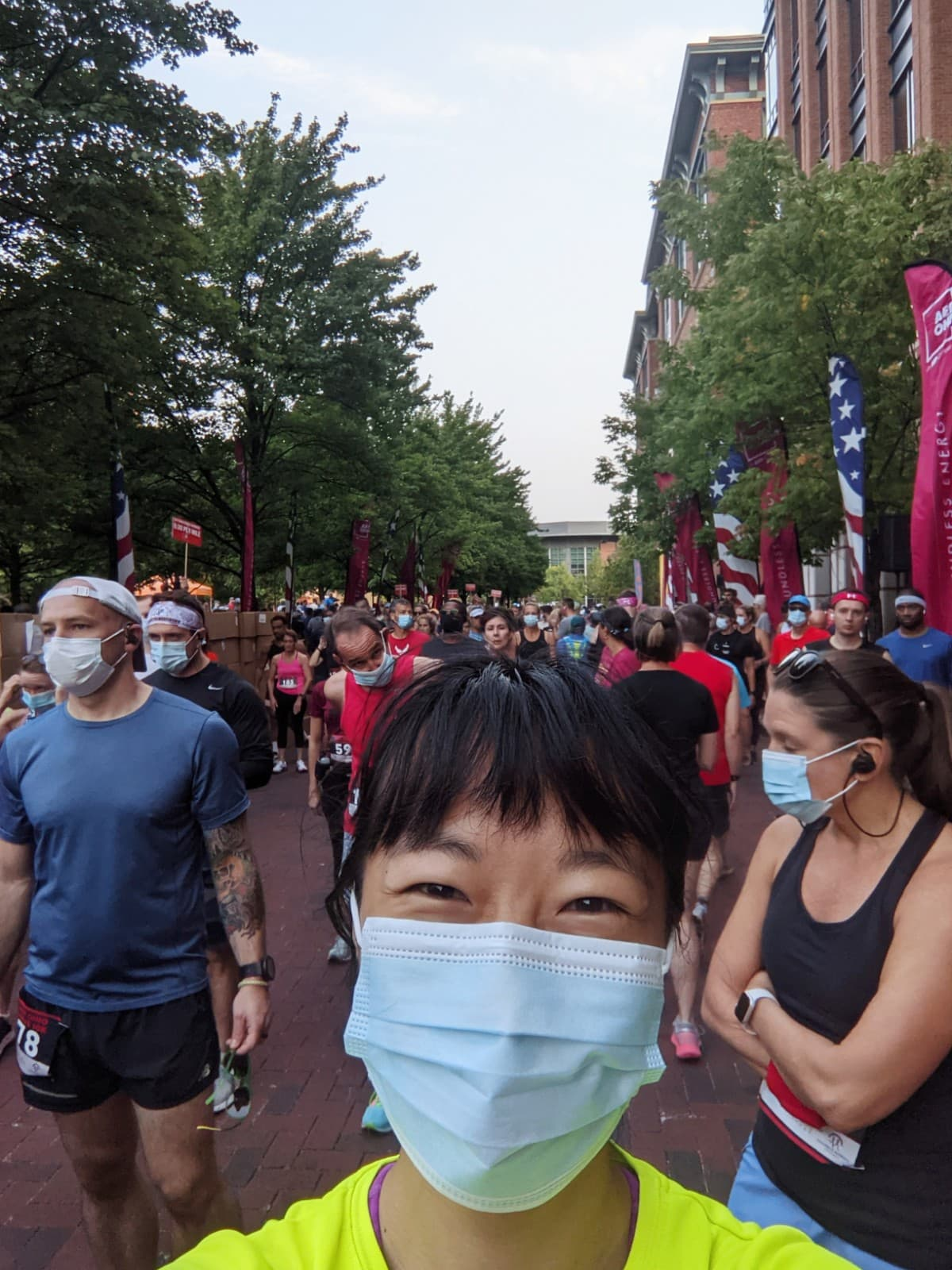 selfie of me wearing a mask at the starting line with runners in the background